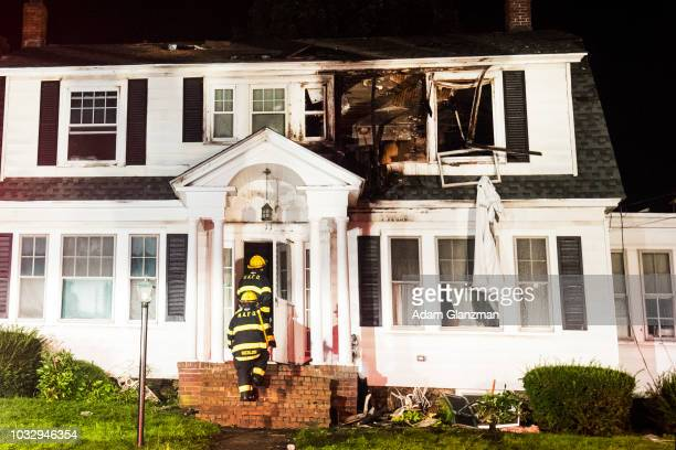 Firefighters inspect a home after a gas explosion on September 13 2018 in North Andover Massachusetts Gas explosions in three communities north of...