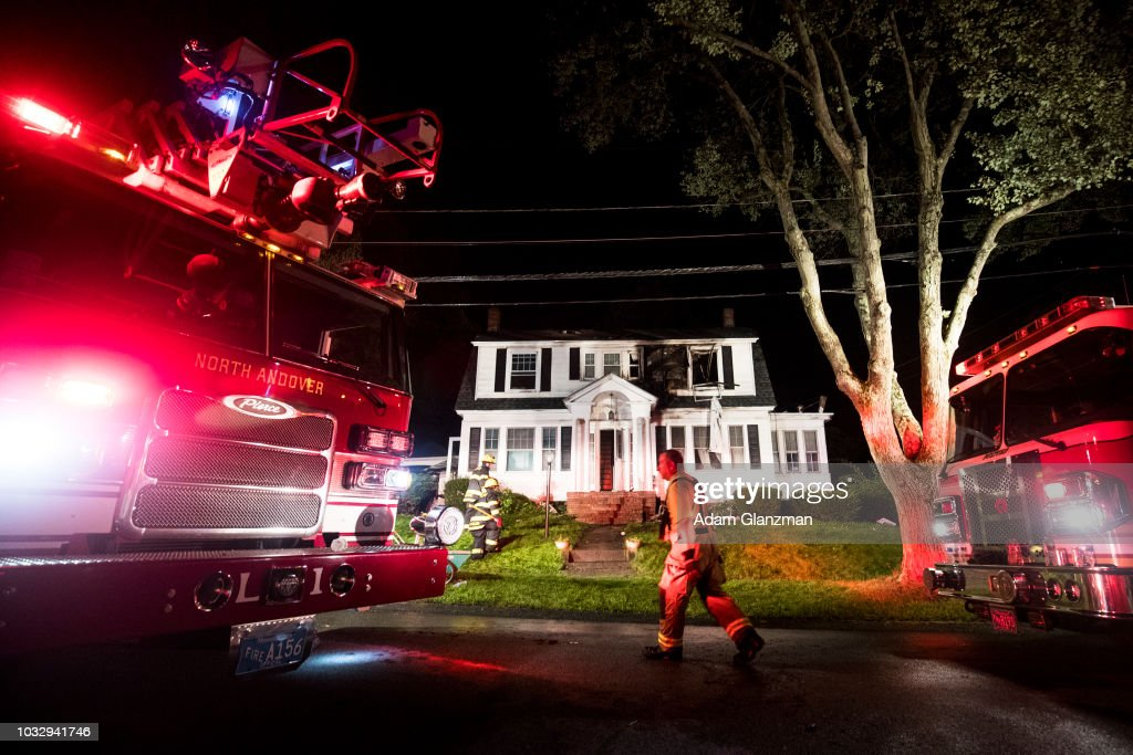 Firefighters inspect a home after a gas explosions on September 13, 2018 in North Andover, Massachusetts. Gas explosions in three communities north of Boston have left multiple homes on fire.