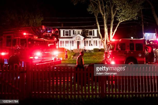Firefighters inspect a home after a gas explosions on September 13 2018 in North Andover Massachusetts Gas explosions in three communities north of...