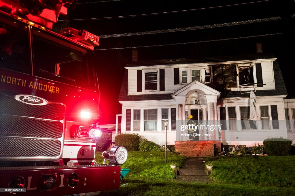 Firefighters inspect a home after gas explosions on September 13, 2018 in North Andover, Massachusetts. Gas explosions in three communities north of Boston have left multiple homes on fire.