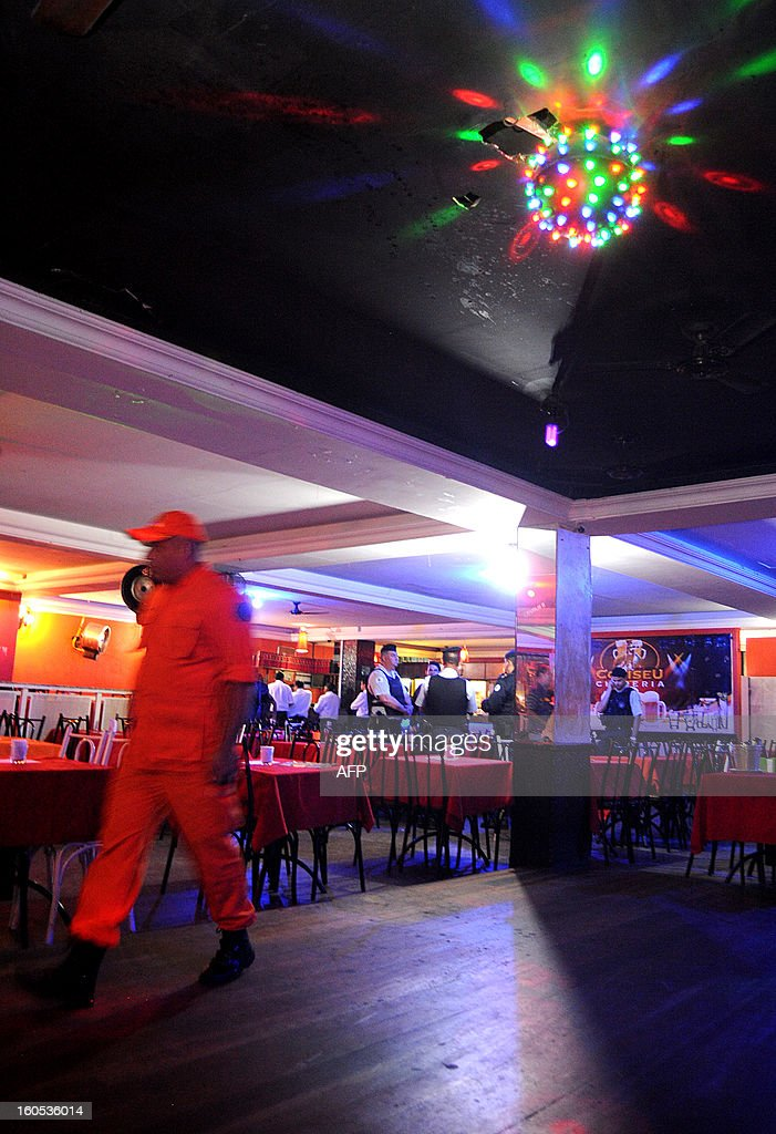 Firefighters inspect a nightclub in a suburb of Brasilia, on February 2, 2013. The Brazilian authorities ordered the inspection of many bars and nightclubs all over the country after the blaze in the Kiss Nightclub in Santa Maria, southern Brazil, that left more than 230 people dead. AFP PHOTO/ Pedro LADEIRA