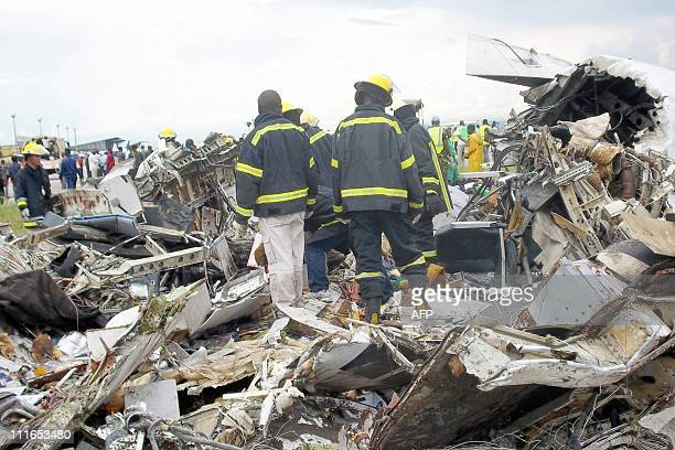 Firefighters inspect the wreckage of a UN plane after it crashed as it tried to land in a storm in Kinshasa on April 4 2011 One person on the plane...