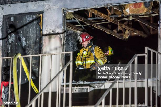 Firefighters investigate the scene of second story fire at the Wateridge Apartments in the 2200 block E Ball Road in Anaheim on Thursday January 18...