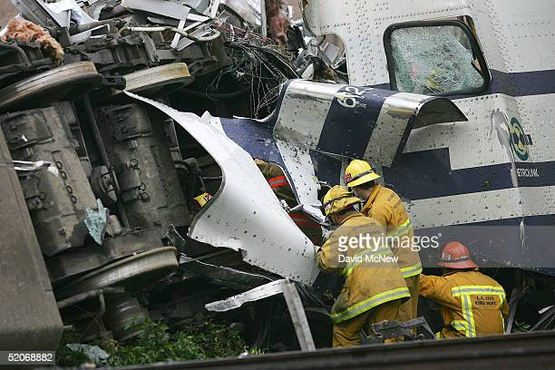 Firefighters investigate the trapped body of a passenger killed in a commuter train wreck January 26 2005 in Glendale California The twotrain wreck...