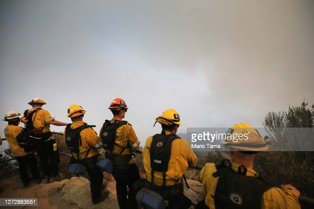 Firefighters keep watch near Mount Wilson Observatory as the Bobcat Fire burns nearby in the Angeles National Forest on September 16, 2020 near...