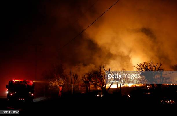 Firefighters keeps their eye on the Lilac fire in Bonsall CA December 8 2017 Currently the wind is calm and the temperature is 51 degrees in Bonsall
