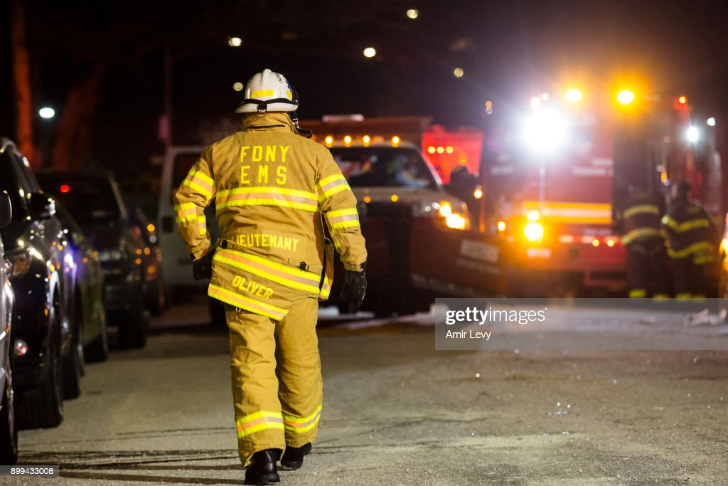 Firefighters leave after putting out a major house fire on Prospect avenue on December 28, 2017 in the Bronx borough of New York City. Over 170 firefighters respond to the evening fire in which at least 12 persons were killed with others injured.