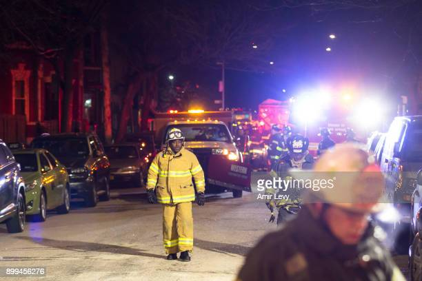 Firefighters leave after putting out a major house fire on Prospect avenue on December 28 2017 in the Bronx borough of New York City Over 170...