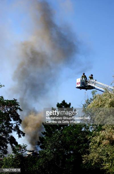 Firefighters look over the scene of a structure fire on Longs Peak Drive in Boulder on Sunday September 3 2006 According to Chief Dan Durkee of the...