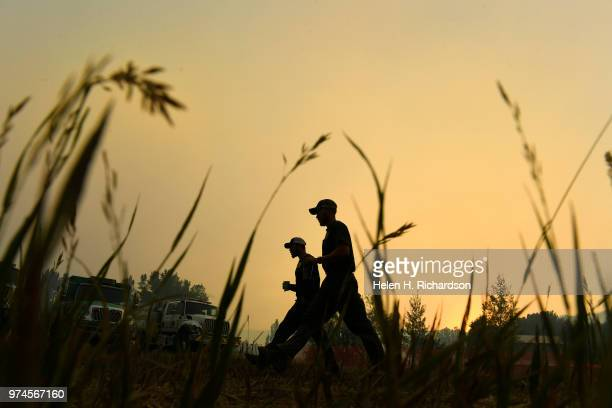 Firefighters make their way back from breakfast at fire camp before heading back out on the fire line of the 416 Fire on June 14 2018 in Hermosa...