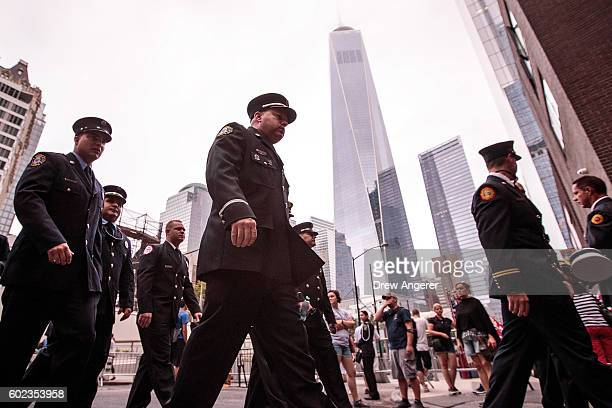 Firefighters make their way to a commemoration ceremony held for the victims of the September 11 terrorist attacks September 11 2016 in New York City...
