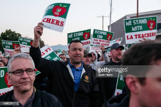 Firefighters march through downtown in support of the city's teacher strike in the early morning of January 22 2019 in Los Angeles California In a...