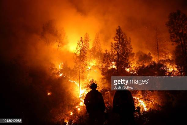 Firefighters monitor a back fire as they battle the Medocino Complex fire on August 7 2018 near Lodoga California The Mendocino Complex Fire which is...