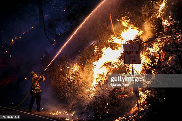 COUNTY CALIF WEDNESDAY AUGUST 17 2016 Firefighters monitor the Blue Cut fire burning alongside Lytle Creek Road in San Bernardino County Calif on Aug...