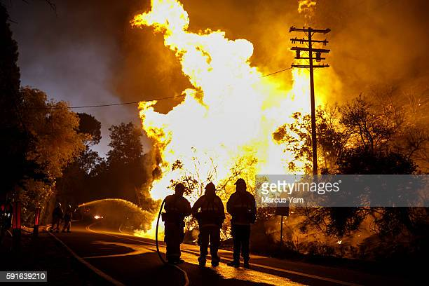 Firefighters monitor the Blue Cut fire traveling on the side of Lytle Creek Road in San Bernardino County Calif on Aug 17 2016