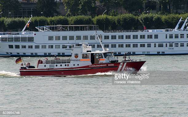 Firefighters motor boat sails the Rhine river past Bonn, Germany, 09 September 2014. Bonn, that offers many touristic attractions, was founded in the...