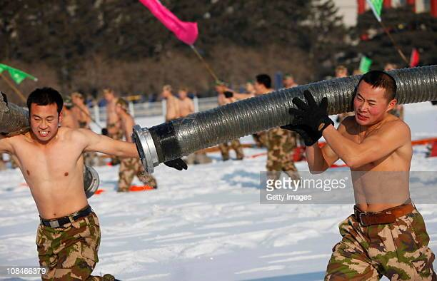 Firefighters of the Changchun fire brigade participate in a drill in the snow at Changchun Culture square on January 27 2011 in Changchun Jilin...