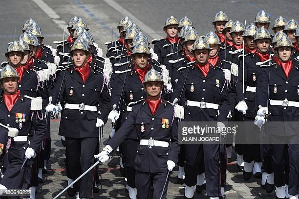 Firefighters of the Ecole nationale superieure des officiers de sapeurspompiers take part in the annual Bastille Day military parade in Paris on July...