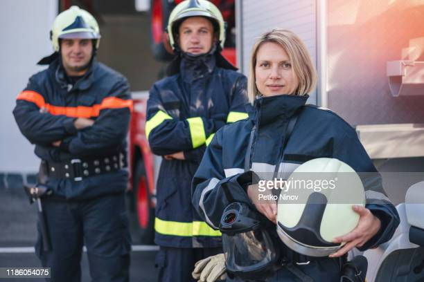 firefighters on duty - stereotypical stock pictures, royalty-free photos & images