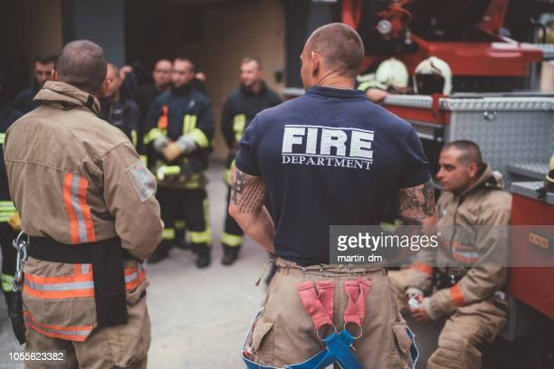 firefighters on meeting before work - firefighter stock pictures, royalty-free photos & images