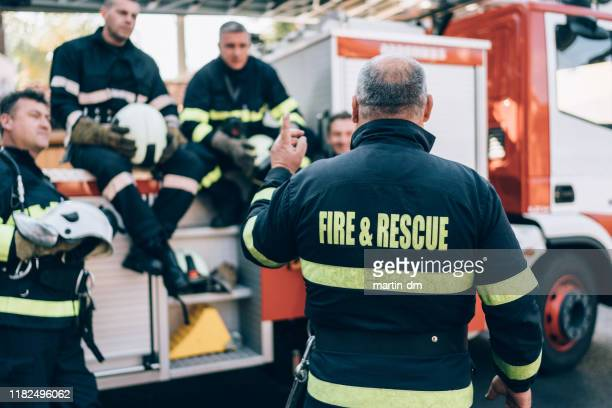 firefighters on meeting before work - rescue services occupation stock pictures, royalty-free photos & images