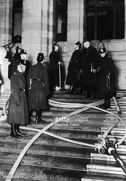 Firefighters on the steps of the Reichstag which was set on fire in the night of February 27th to the 28th 1933