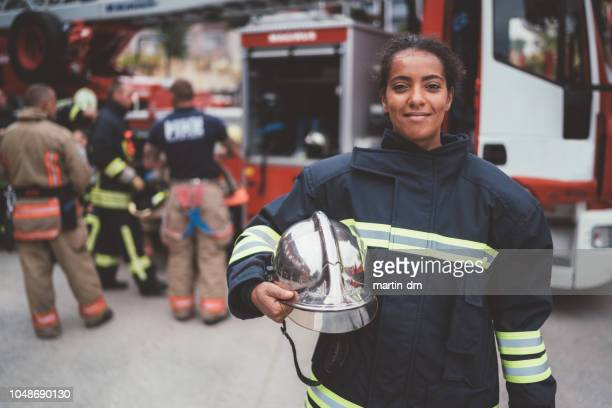 firefighter's portrait - firefighter stock pictures, royalty-free photos & images