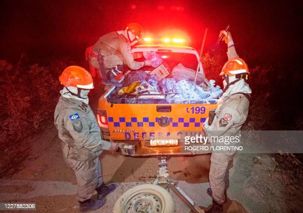 Firefighters prepare to fight forest fires in Pocone, Pantanal region , Mato Grosso State, Brazil on July 31, 2020.