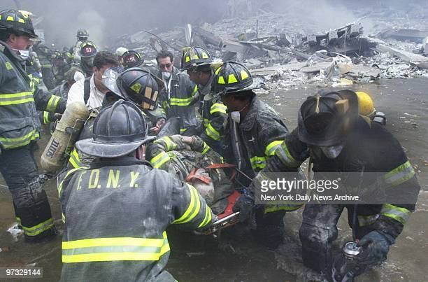 Firefighters pull survivors from the rubble of the World Trade Center after it was struck by a commercial airliner in a terrorist attack. A hijacked...