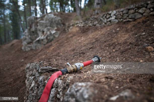 Firefighters pump water in seen in the mountains near L'Aquila August 4 2020 Fifth day of fear and concern about the fire that is devastating the...