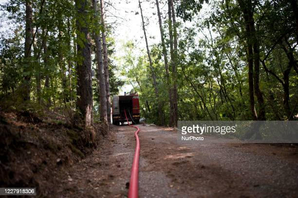 Firefighters pump water in the mountains near L'Aquila August 4 2020 Fifth day of fear and concern about the fire that is devastating the mountains...