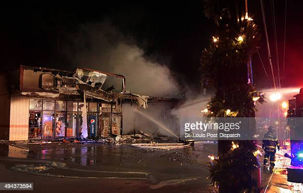Firefighters put out a blaze at the Little Caesar's Pizza along North Florissant Road in Ferguson Mo on Nov 24 2014