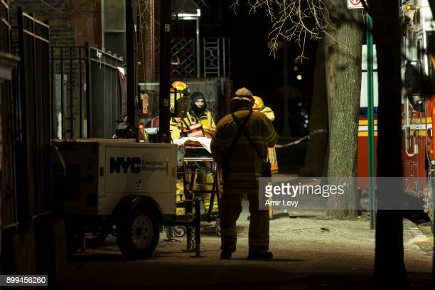 Firefighters put out a major house fire on Prospect avenue on December 28 2017 in the Bronx borough of New York City Over 170 firefighters respond to...