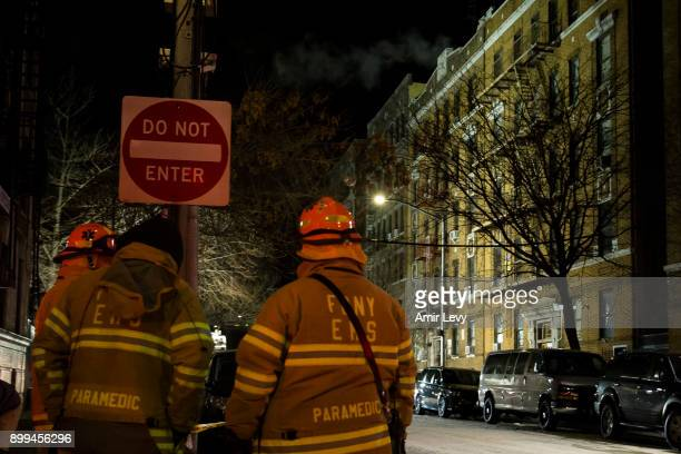 Firefighters put out a major house fire on Prospect avenue on December 29 2017 in the Bronx borough of New York City Over 170 firefighters respond to...