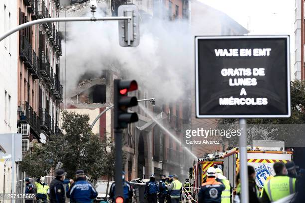 Firefighters put out flames after Six floors collapsed on a building after a large explosion on Toledo Street in central Madrid on January 20, 2021...