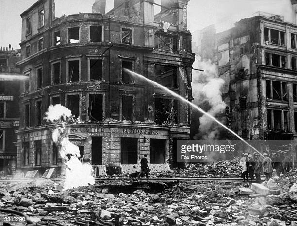 Firefighters put out the last of the flames from a Lloyd's Bank building after a German air raid on London