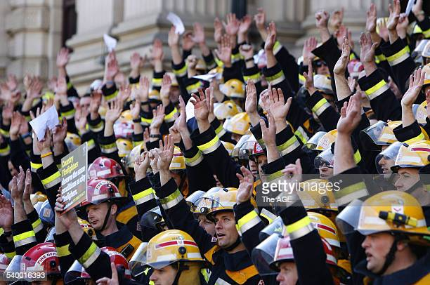 1000 CFA Firefighters rally in Spring St for better conditions and get a peep show from women in a nearby hotel room THE AGE NEWS Picture by SIMON...