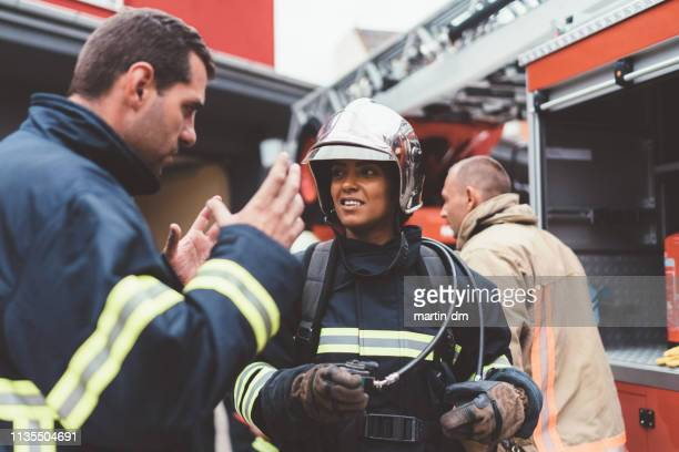 firefighters ready for rescue - firefighter stock pictures, royalty-free photos & images