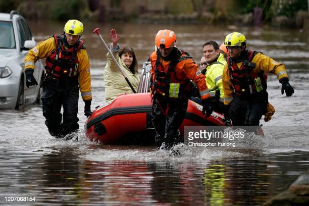 Firefighters rescue staff and residents from a care home in the village of Whitchurch on the banks of the River Wye following flooding from Storm...