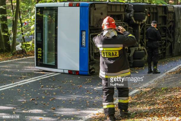 Firefighters rescuers police officers and paramedics in action are seen in Gdynia Poland on 2 October 2017 As a result of the over speed the city bus...