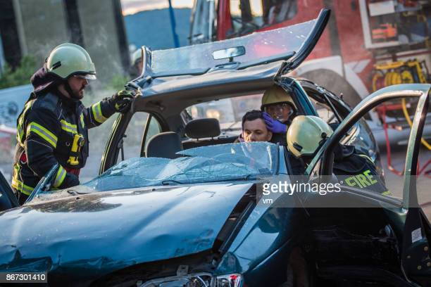 Firefighters rescuing the driver