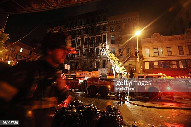 Firefighters respond to a sevenalarm blaze on Grand Street in Chinatown on April 12 2010 in New York City Over 250 firefighters have responded to the...