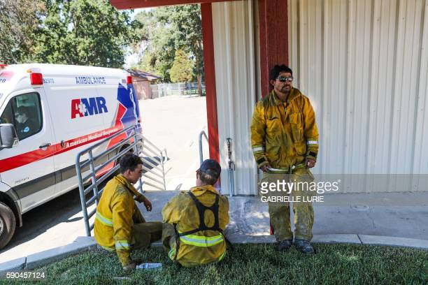 Firefighters rest after helping with the destruction caused by the Clayton Fire in Lower Lake California August 16 2016 A man was arrested and...