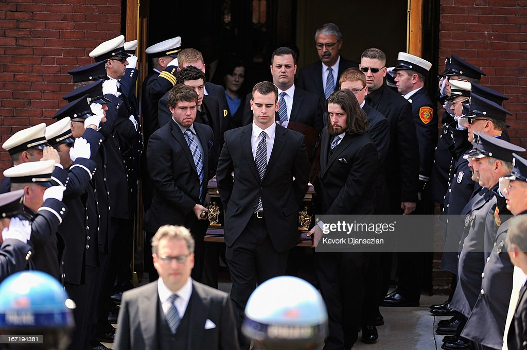 Firefighters salute as pallbearers carry the casket of Krystle Campbell, a victim of the Boston Marathon bombing, from St. Joseph Catholic Church after a funeral service on April 22, 2013 in Medford, Massachusetts. A manhunt ended for Dzhokhar A. Tsarnaev, 19, a suspect in the Boston Marathon bombing after he was apprehended on a boat parked on a residential property in Watertown, Massachusetts. His brother Tamerlan Tsarnaev, 26, the other suspect, was shot and killed after a car chase and shootout with police. The bombing, on April 15 at the finish line of the marathon, killed three people and wounded at least 170.