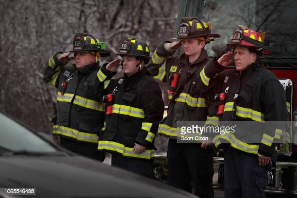 Firefighters salute as the remains of Chicago Police Officer Samuel Jimenez arrive at Ridgewood Memorial Park on November 26 2018 in Des Plaines...