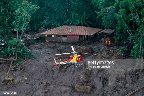 Firefighters search for bodies in the region of Corrego do Feijao in Brumadinho two days after the collapse of a dam at an ironore mine belonging to...