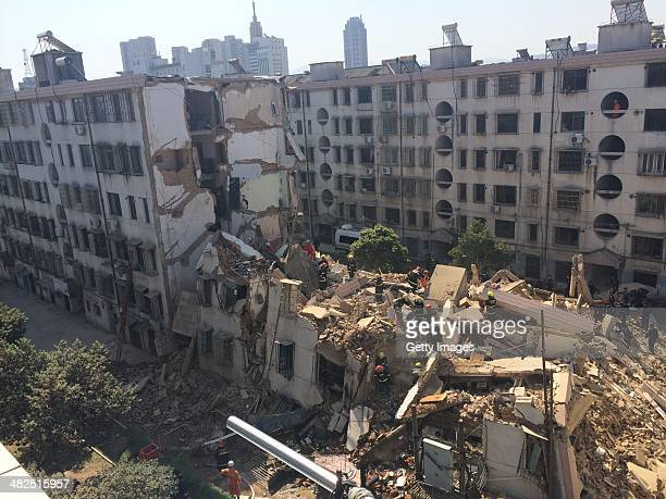 Firefighters search for survivors after an apartment building collapsed on April 4 2014 in Fenghua Zhejiang Province of China A residential building...