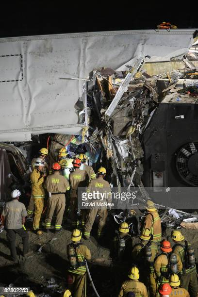 Firefighters search for survivors in the wreckage of a Metrolink commuter train that collided headon with a freight train on the previous afternoon...