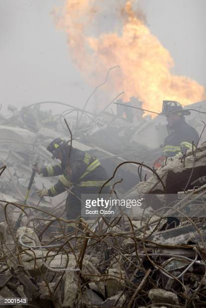 Firefighters search for victims at the site of a simulated building collapse May 15, 2003 in Bedford Park, Illinois. Approximately 600 firefighters...