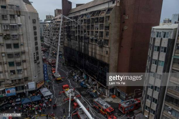 Firefighters search for victims from a residential building in the wake of a fire on October 14, 2021 in Kaohsiung, Taiwan. Additional deaths are...